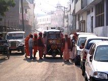 Sadhus Around Rickshaw Royalty Free Stock Photo