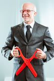 Sadistic accountant ready to cuts. Grotesque sadistic accountant ready to cuts with giant red scissors Stock Image