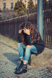 Sadl girl posing in an urban context Royalty Free Stock Photos