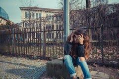 Sadl girl posing in an urban context Stock Image
