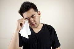 Sadly. A man hold handkerchief look sad Royalty Free Stock Images