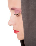 Sadness. Portrait (profile) of a young elegant woman wearing a hood Stock Photos