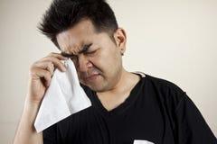 Sadness. A man holding handkerchief crying Stock Photos