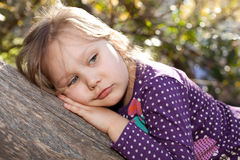 Sadness. Portrait of a sad little girl outdoors Royalty Free Stock Photography