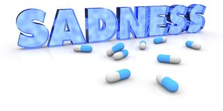 Sadness. Written sadness with pills in front Stock Image