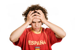 Sadness. Spanish young man supporter, isolated on white Stock Image