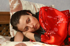 Sadness. Sad young jewess wearing a red robe Royalty Free Stock Photo