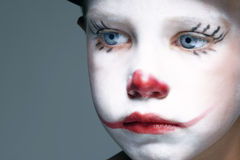 Sadness. Portrait of make up clown boy with red nose Stock Photos