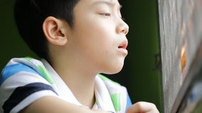 Sadness asian kid sit and depressed ,looking out of windows stock footage