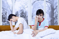 Sadness couple after quarreling at home Royalty Free Stock Images