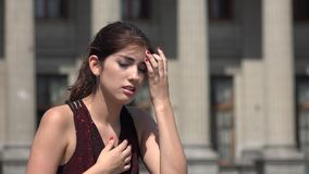 Sadness crying anxiety woman at courthouse. A young hispanic adult female stock footage