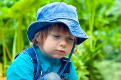 Sadness dirty beauty boy in grass Stock Images