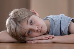 Sadness because of divorce. Young boy is sad because of his parents divorce royalty free stock photography