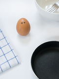 Sadness emotion of egg with pan on white background Royalty Free Stock Images