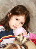 Sadness girl. With her doll, child depression Stock Images