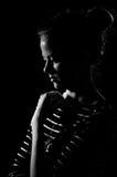 Sadness girl in black. Sadness girl on black background, black and white image Stock Photos