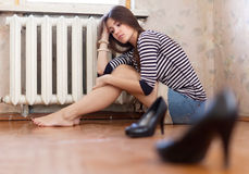 Sadness girl sitting on the floor. In the corner Stock Images