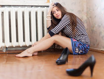 Sadness girl. Sitting on the floor in the corner Royalty Free Stock Photo