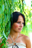 Sadness girl and weeping willow Royalty Free Stock Photography