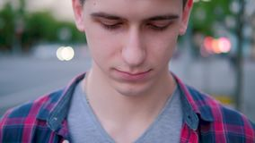 Sad guilt shy insecure portrait man looking down stock video footage