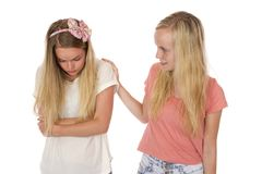 Sadness and Helping Friend. A young lady consoling a teen with a problem Royalty Free Stock Photography