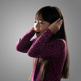 Sadness. Little girl cry and screaming, Isolated on grey background Royalty Free Stock Photo