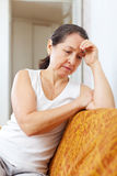 Sadness mature woman. At  home Royalty Free Stock Photos