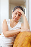Sadness mature woman Royalty Free Stock Images