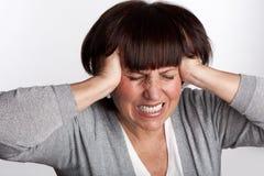 Sadness mid woman. Sadness mature woman. Isolated on gray Stock Photo