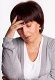 Sadness mid woman. Sadness mature woman. Isolated on gray Stock Image