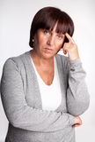 Sadness mid woman. Sadness mature woman. Isolated on gray Stock Photography