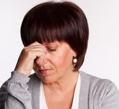 Sadness mid woman Royalty Free Stock Photo