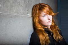 Sadness, moody portrait, beautiful redhead girl. Royalty Free Stock Photos
