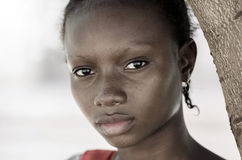 Sadness Poverty Symbol. No to racism and poverty background: Afr. Sadness Poverty Symbol - African Black Girl Symbol. No to racism and poverty background Stock Image