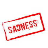 Sadness red rubber stamp isolated on white. Sadness red rubber stamp isolated on white background. Grunge rectangular seal with text, ink texture and splatter Stock Photos