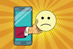 Sadness resentment emoji emoticons in smartphone. Pop art retro vector illustration Stock Photo