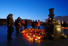 Sadness in Warsaw. People mourning on Jozef Pilsudski square in Warsaw after air crash of polish national airplane, April 17, 2010 Stock Image