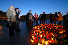 Sadness in Warsaw. People mourning on Jozef Pilsudski square in Warsaw after air crash of polish national airplane, April 17, 2010 Stock Photos