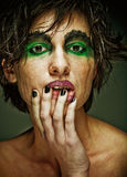 Sadness woman with bright make up. Sadness. Portrait young woman in depression.Creative make-up.r Stock Photography