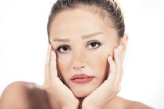 Sadness. Woman cupping face with sadness or worry Royalty Free Stock Images