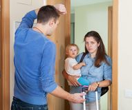 Sadness woman leaving from home. Sadness women with child leaving from home Royalty Free Stock Image