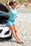 Sadness woman is standing near broken car Royalty Free Stock Photos