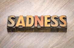 Sadness word abstract in wood type. Sadness word abstract in vintage letterpress wood type Royalty Free Stock Photo