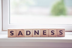 Sadness word made of wood Royalty Free Stock Image