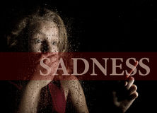 Sadness written on virtual screen. hand of frightened young girl melancholy and sad at the window in the rain. Sadness written on virtual screen. hand of royalty free stock photo