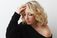 Sadness young girl. Sadness blonde young girl on white background Royalty Free Stock Images
