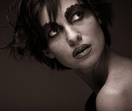 Sadness - young woman in depression.Creative make-up. Stock Image