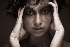 Sadness - young woman in depression.Creative make-up. Royalty Free Stock Photos