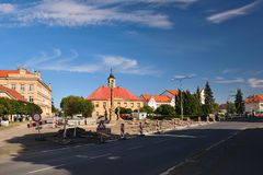 Sadska, Czech republic - July 07, 2018: road, column and historical houses on Palackeho Namesti square during reconstruction in su. Mmer sunny evening in Kersko Stock Images