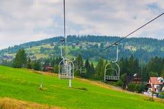 Sadza dźwignięcie w górze w Zakopane, Polska zdjęcie royalty free